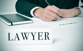 29007194 - a man in his desk with a nameplate in front of him with the word lawyer written in it